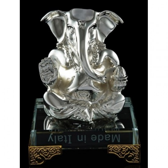 Silver plated metal Ganesha on a glass base